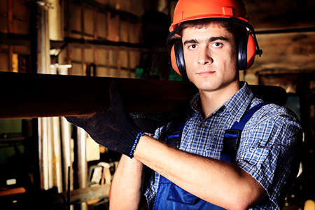 factory worker: Industry: a worker at a manufacturing area.