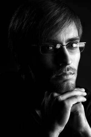 Portrait of a handsome man over black background. Stock Photo - 14772428