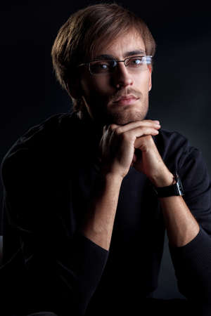 Portrait of a handsome man over black background. Stock Photo - 14772425