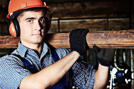 metal worker: Industry: a worker at a manufacturing area.