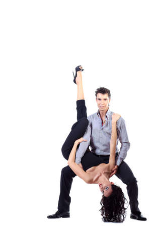 Beautiful couple of professional artists dancing passionate dance. Isolated over white. photo