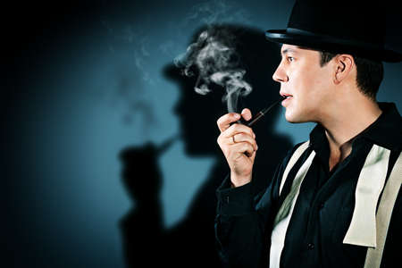 Portrait of a retro detective in pot hat smoking his pipe. photo