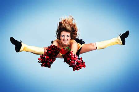Beautiful girl cheerleader posing at studio.  photo