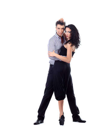 rumba: Beautiful couple of professional artists dancing passionate dance. Isolated over white. Stock Photo