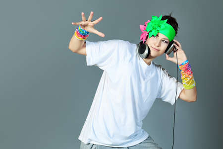 trendy girl: Trendy girl in headphones dancing on disco. Stock Photo