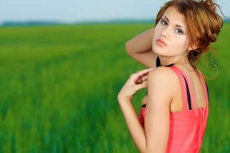 Shot of a beautiful woman posing outdoor. photo