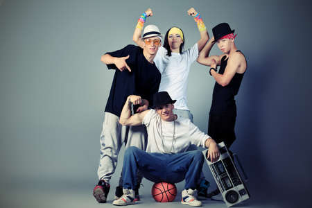 Group of modern dancers dancing hip-hop at studio. photo