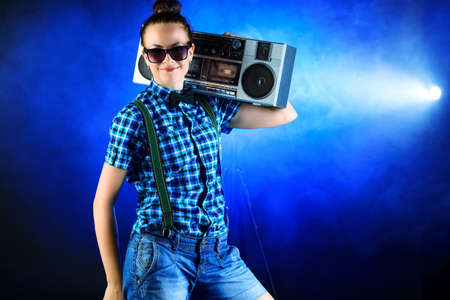 Cool girl dancing with recorder on disco. photo