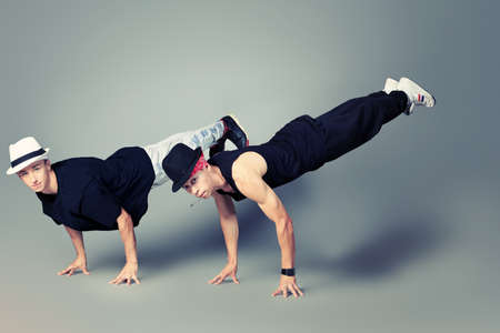 Two modern dancers dancing hip-hop at studio. photo