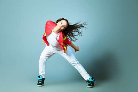 dancing girl: Modern girl dancing hip-hop at studio. Stock Photo