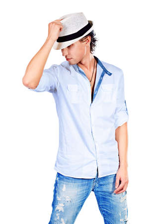 macho man: Portrait of a handsome young man in hat. Isolated over white background.