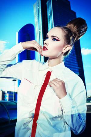 Vogue model posing over big city background. Stock Photo - 14952074