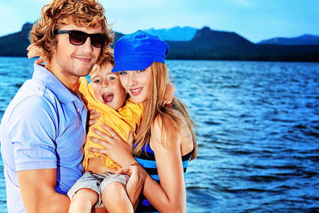 ittle: Portrait of a happy family with ittle son on vacation.