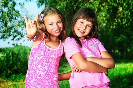 Two cheerful girls at the summer park. photo