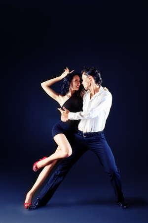 rumba: Beautiful couple of professional artists dancing passionate dance. Stock Photo