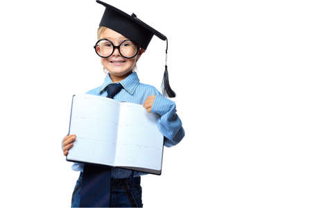 Little boy in spectacles and suit standing with opened diary. Isolated over white background. Stock Photo - 15068757