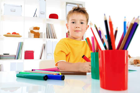 Little boy drawing in his notebook at home. Stock Photo - 15068760
