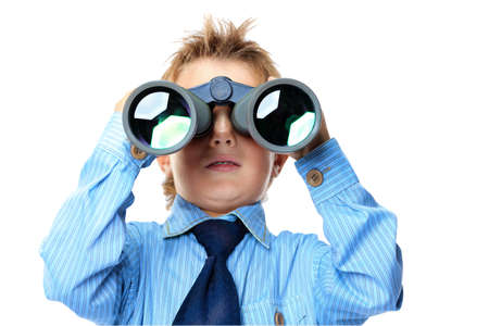 Curious little boy is looking through binoculars. Isolated over white background. Stock Photo - 15029576