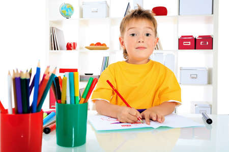Little boy drawing in his notebook at home. Stock Photo - 15029571
