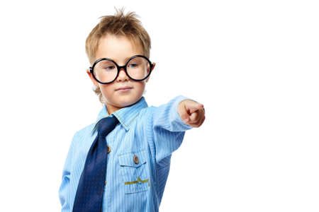 Little boy in spectacles and suit pointing the finger at something. Isolated over white background. Stock Photo - 15029564