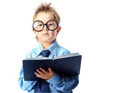 Little boy in spectacles and suit standing with a diary. Isolated over white background. Stock Photo - 15029570