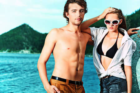 Beautiful young couple having holidays on the sea. photo