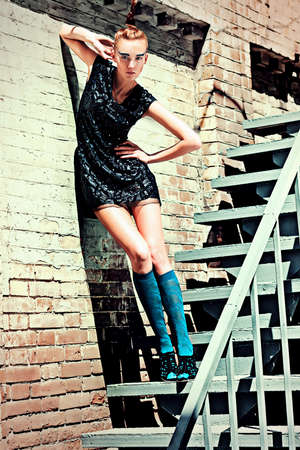 Fashion woman posing on a stairs over brick wall. Stock Photo - 15068777
