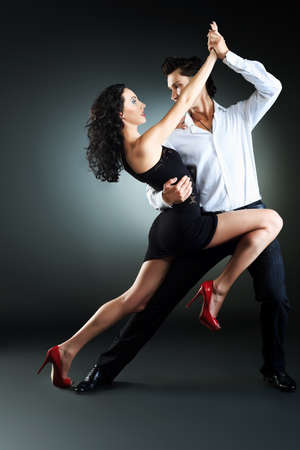 salsa dance: Beautiful couple of professional artists dancing passionate dance. Stock Photo