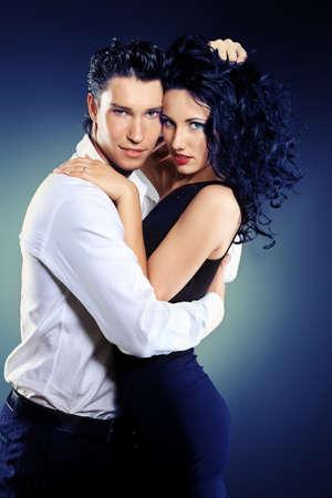 elegant couple: Beautiful couple of professional artists dancing passionate dance. Stock Photo