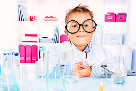 pediatrics: Cute boy is making science experiments in a laboratory. Education. Stock Photo