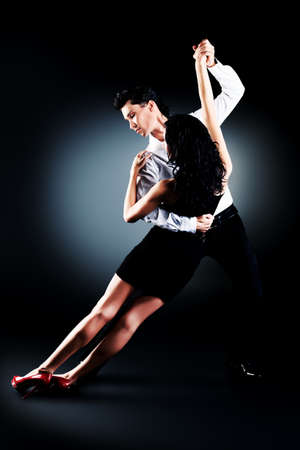salsa dancer: Beautiful couple of professional artists dancing passionate dance. Stock Photo