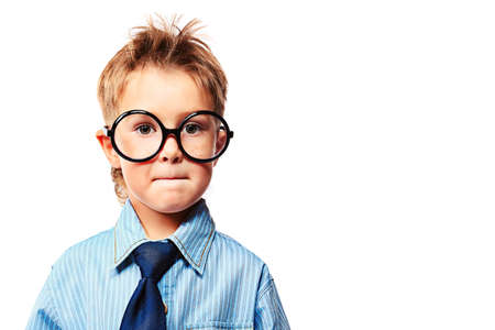 Portrait of a seus little boy in spectacles and suit. Isolated over white background. Stock Photo - 15236960