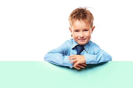 Portrait of a little boy in shirt and tie holding white board. Isolated over white background. Stock Photo - 15236926