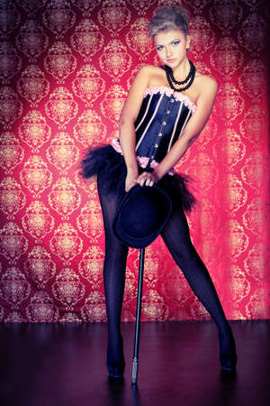 cabaret: Portrait of a sexy beautiful woman posing at studio.