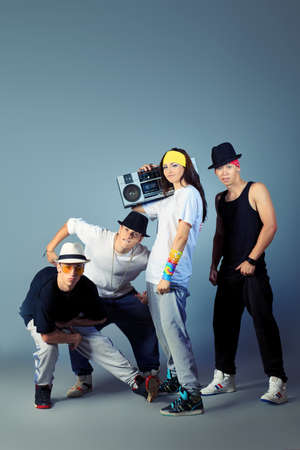 Group of modern dancers posing at studio. photo