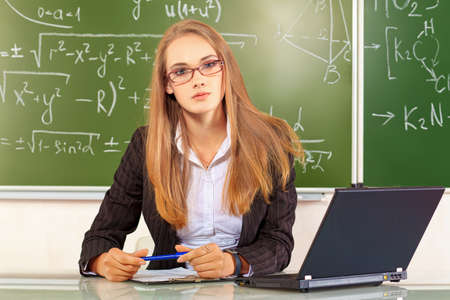 lecturing: Portrait of a teacher giving a lecture at a classroom.. Stock Photo