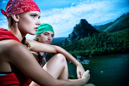 recreational sports: Couple of tourists are standing at the top of a mountain with a feeling of freedom.
