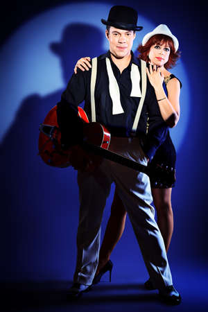 Couple of professional singers in retro style posing in costumes at studio. Stock Photo - 15353709