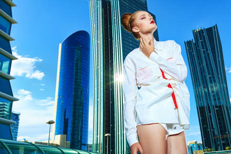 Fashion model posing over big city background. Stock Photo - 15353707