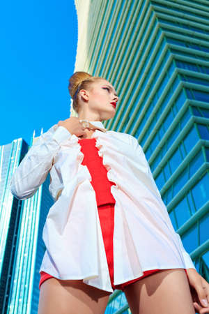 Fashion model posing over big city background. Stock Photo - 15353703