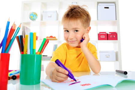 Little boy drawing in his notebook at home. Stock Photo - 15353704