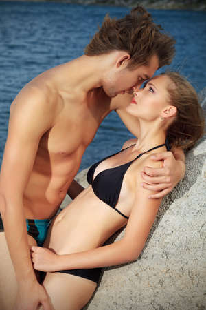 Beautiful young couple in love  having holidays on the sea. photo
