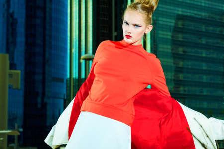 Vogue model posing over big city background. photo