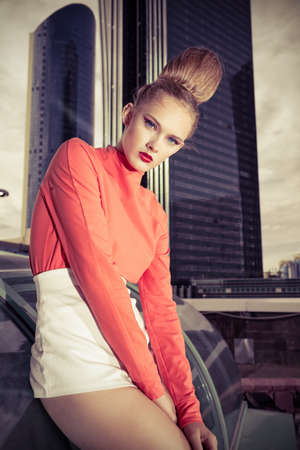 Vogue model posing over big city background. Stock Photo - 15323920