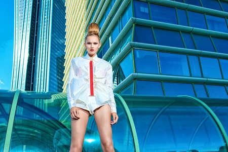 Fashion model posing over big city background. Stock Photo - 15323949