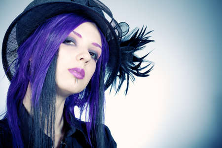Portrait of a grunge girl with purple hair. photo
