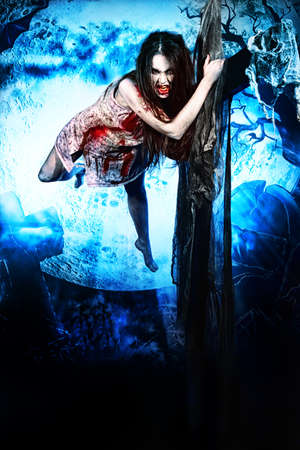 bloodthirsty: Bloodthirsty vampire flying at the night cemetery in the mist and moonlight. Stock Photo