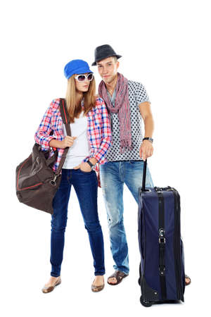 Couple of young people standing together with suitcases over white background. photo