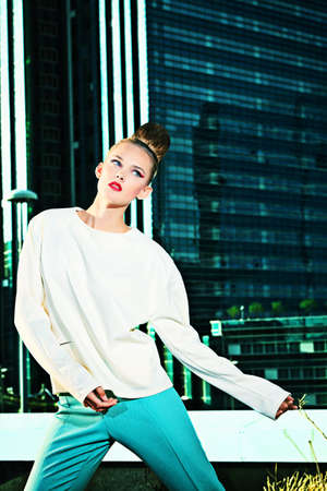 Vogue model posing over big city background. photo