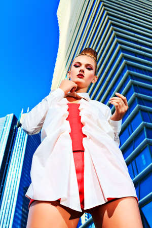 Fashion model posing over big city background. Stock Photo - 15389058